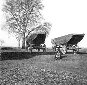 Pontoon boats on wagons.