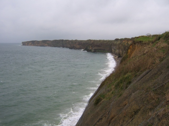 The cliffs at La Pointe du Hoc. The defense of the area fell to the 352nd Division, of Field Marshal Erwin Rommel's Army Group B. The German's rolled grenades down on the Rangers, but 18 Allied bombers pummeled the area, as did well directed fire from the H.M.S. Talybont and USS Satterlee; it was combined operations at its finest. Rudder's men gained the top only to find the battery had been withdrawn.