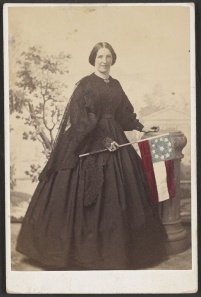 Mrs. Ridgley posed with the Confederate flag in this photograph, c. 1861-1865. It is much like the one Sarah Dawson would have made and worn in May, 1862. Courtesy of the Library of Congress.