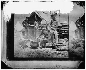 Camp of the 71st New York. Soldiers preparing supper at the cookhouse. Courtesy of the Library of Congress