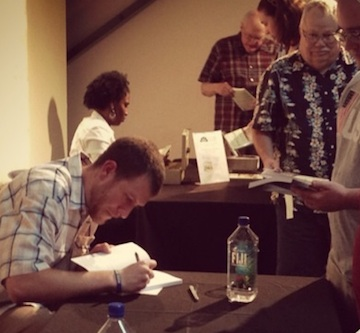 Readers stand in line at the Fredericksburg Area Museum as Phill Greenwalt signs copies of his books