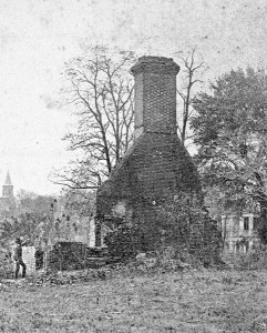 C.1900 image showing the remains of the one of the advance buildings for the Governors Palace. These two flanking structures were all that remained of the 18th century complex. They were reportedly disassembled by Union fatigue details and the bricks were utilized for the improvement of Fort Magruder. Photo in the collections of Colonial Williamsburg.