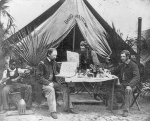 Members of the 3rd New Hampshire Regiment reading outside their tent in Port Royal, S.C.