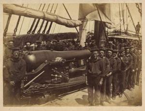 Sailors standing next to a pivot gun on the U.S.S. Pocahontas. The Pocahontas was present at the Battle of Port Royal, and maintained the blockade of South Carolina, Georgia, and Florida. LOC.
