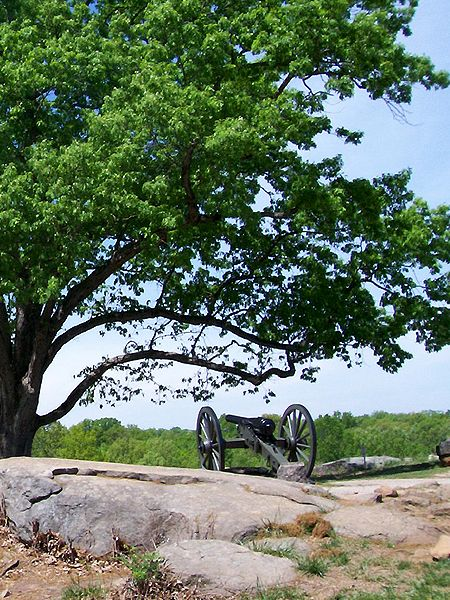 "Gettysburg Battlefield, Adams County PA: This photograph was taken from the backside of ""Devil's Den"" at Gettysburg Battlefield in Pennsylvania. This is my favorite shot that I've taken to date as the contrast between the beautiful trees and the grimly positioned Federal cannon symbolize the contradiction of war."